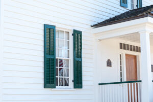 colonial home with green window shutters