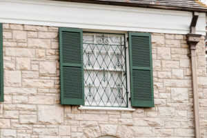 green window shutter with grills