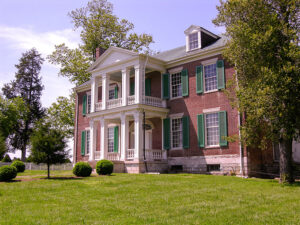 colonial home with a beautiful lawn